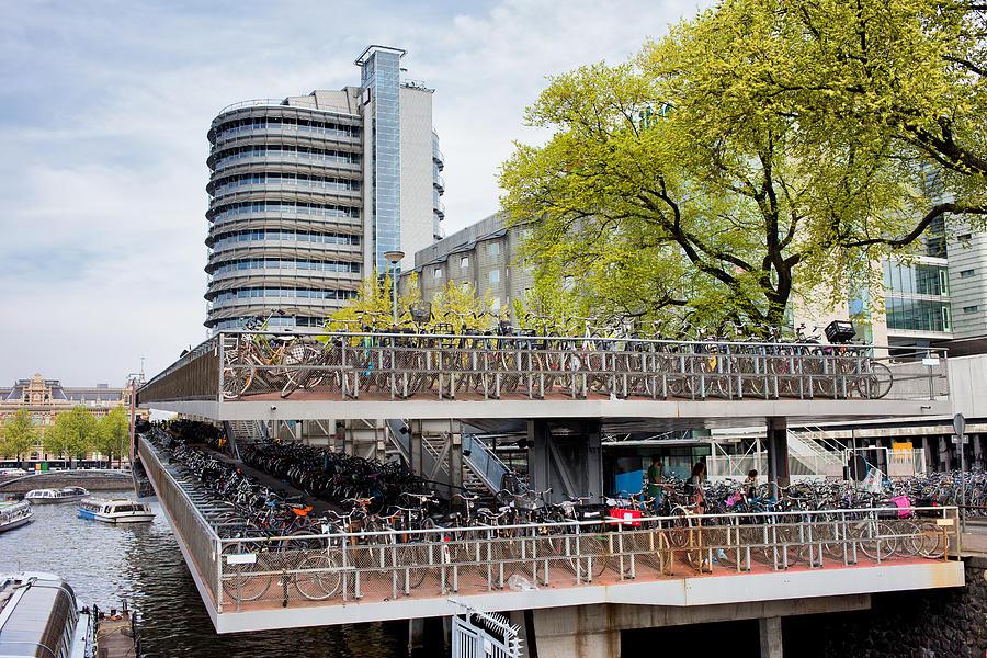 Amsterdam Photograph - Bikes Parking In Amsterdam by Artur Bogacki