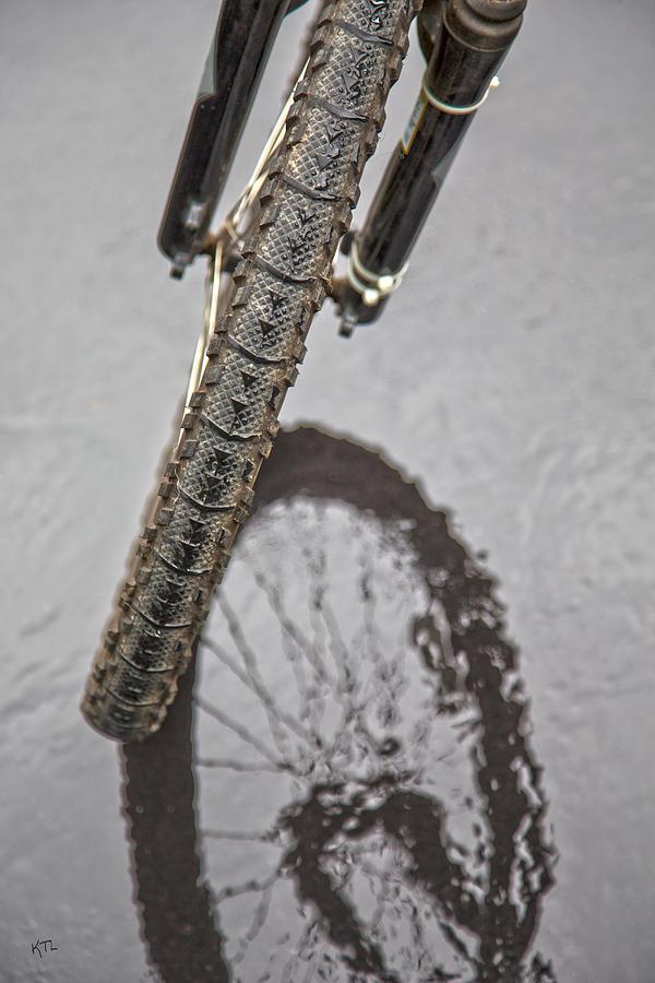 Biking In The Rain by Karol Livote