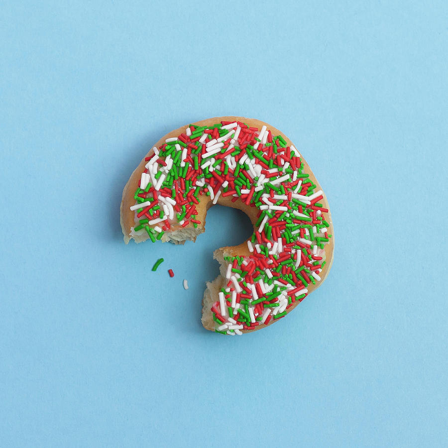 Bite Out Of A Sprinkle Donut, On A Blue Photograph by Steven Errico