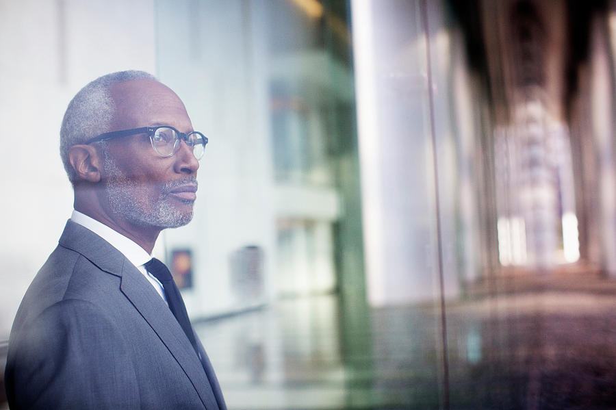 Black Businessman Looking Out Window Photograph by Hill Street Studios Llc