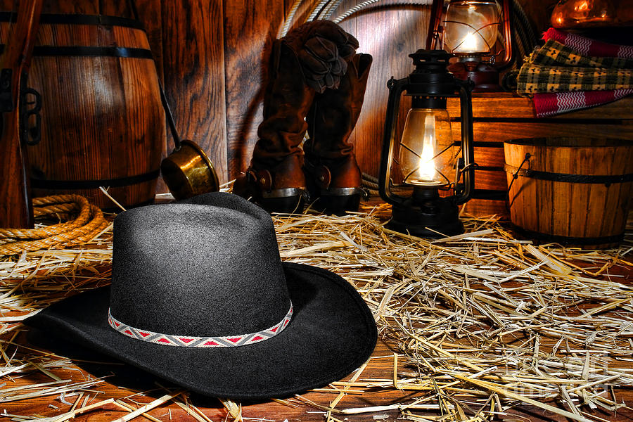 Western Photograph - Black Cowboy Hat In An Old Barn by Olivier Le Queinec
