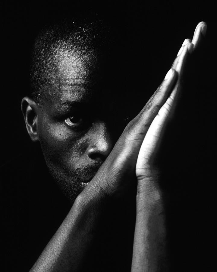 Black Man With Praying Hands Photograph By Martin Sullivan