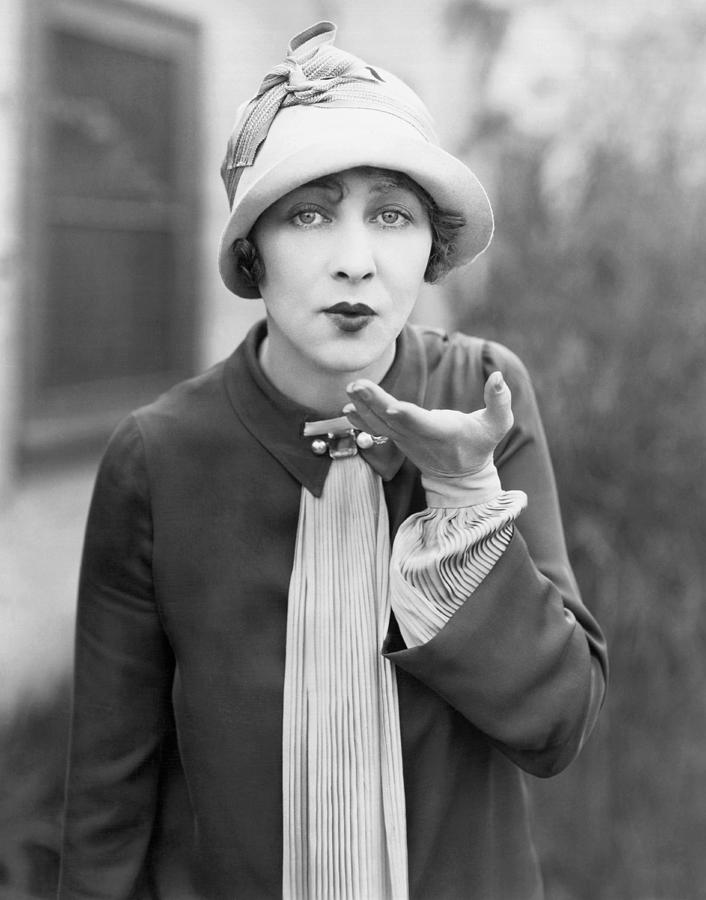 1920 Photograph - Blowing A Kiss by Underwood Archives