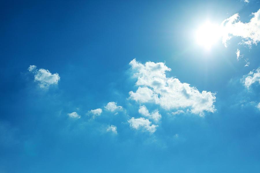 Blue Sky and Sun Photograph by Runstudio