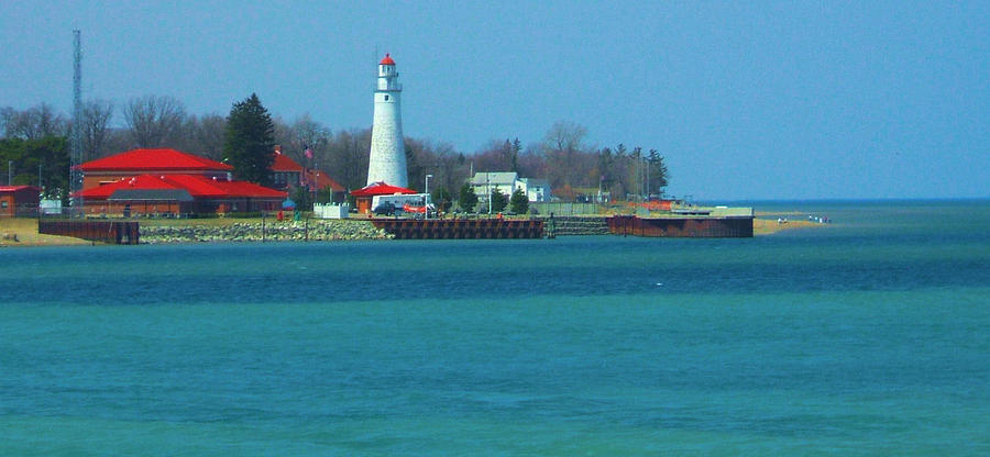 Lighthouse Photograph - Blue Water Lighthouse by Peg Holmes