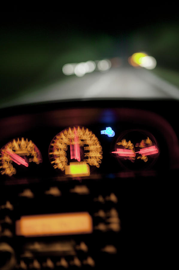 Blurred Illuminated Car Dashboard Photograph by Johner Images