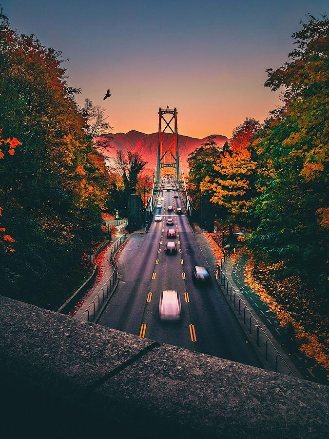 Blurred Motion Of Cars On Suspension Bridge During Sunset Photograph by Michael Wu / EyeEm