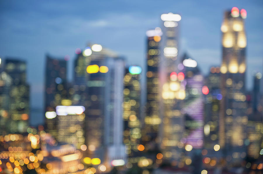 Blurred View Of City Skyline Lit Up At Photograph by Jacobs Stock Photography Ltd