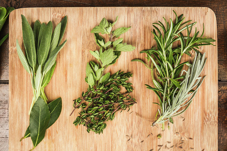 Board With Whole Leaf Herbs Photograph by Manuel Sulzer