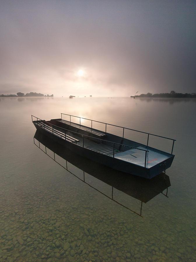 Boat On Foggy Lake Photograph