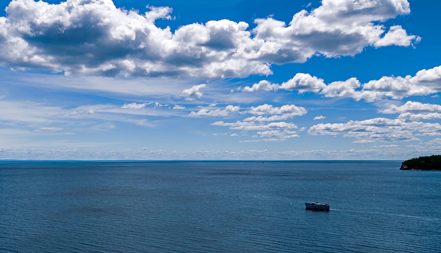 Boat on Lake Superior Photograph by Lonnie Paulson