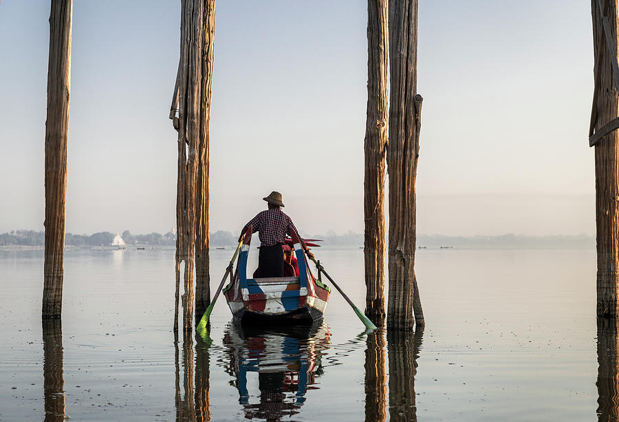 Boat Passing Underneath U Bein Bridge Photograph by Martin Puddy