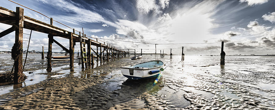 Boats at low tide by Adrian Brockwell