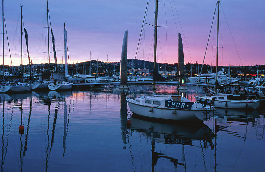Boats Moored In Harbour At Sunset Photograph by David C Tomlinson