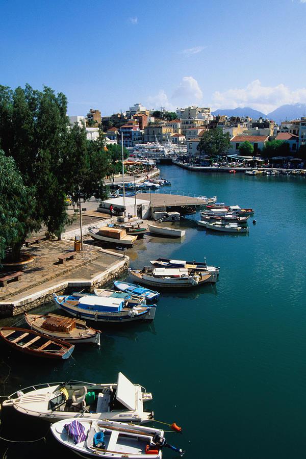 Boats Moored On Lake Voulismeni - Agios Photograph by John Elk