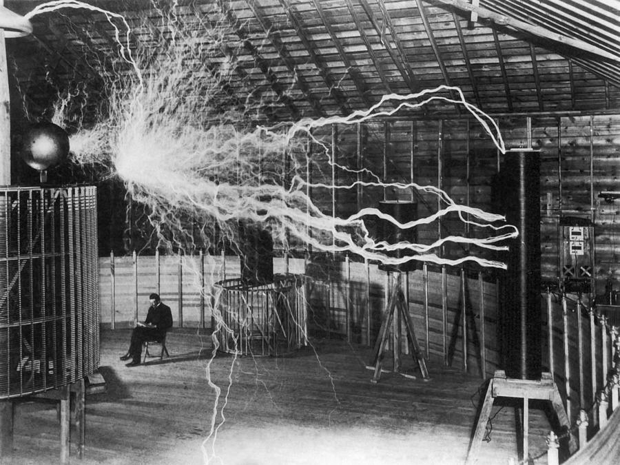 Bolts of electricity discharging in the lab of Nikola Tesla. Photograph by John Parrot/Stocktrek Images