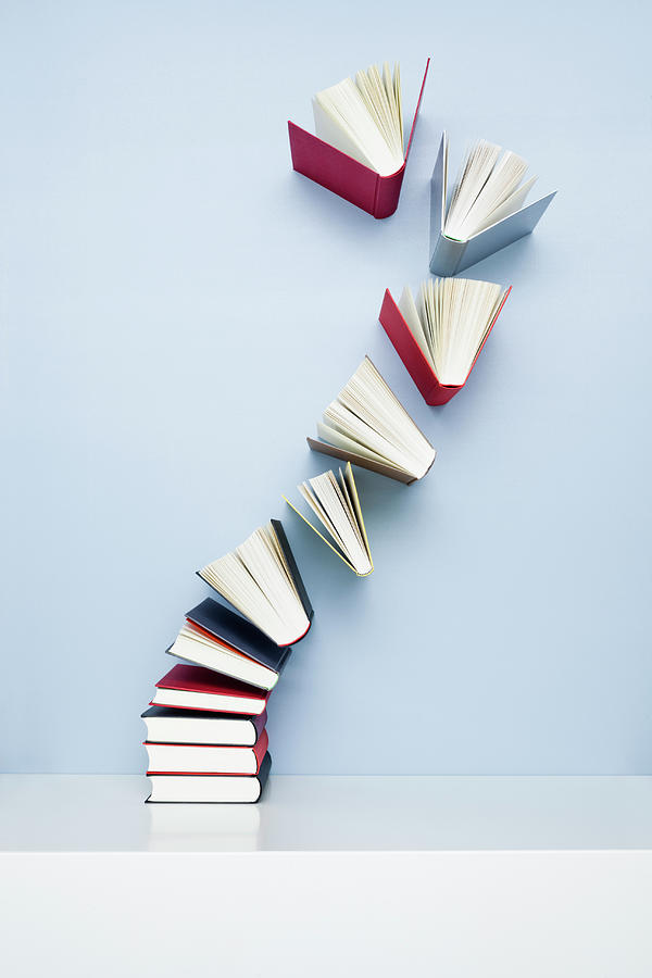Books Taking Off From A Stack Photograph by Jorg Greuel