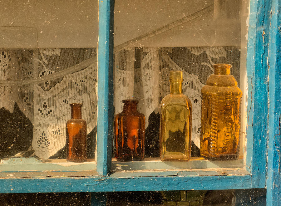Bottles Photograph - Bottles in a Fishing Shack by Nancy De Flon