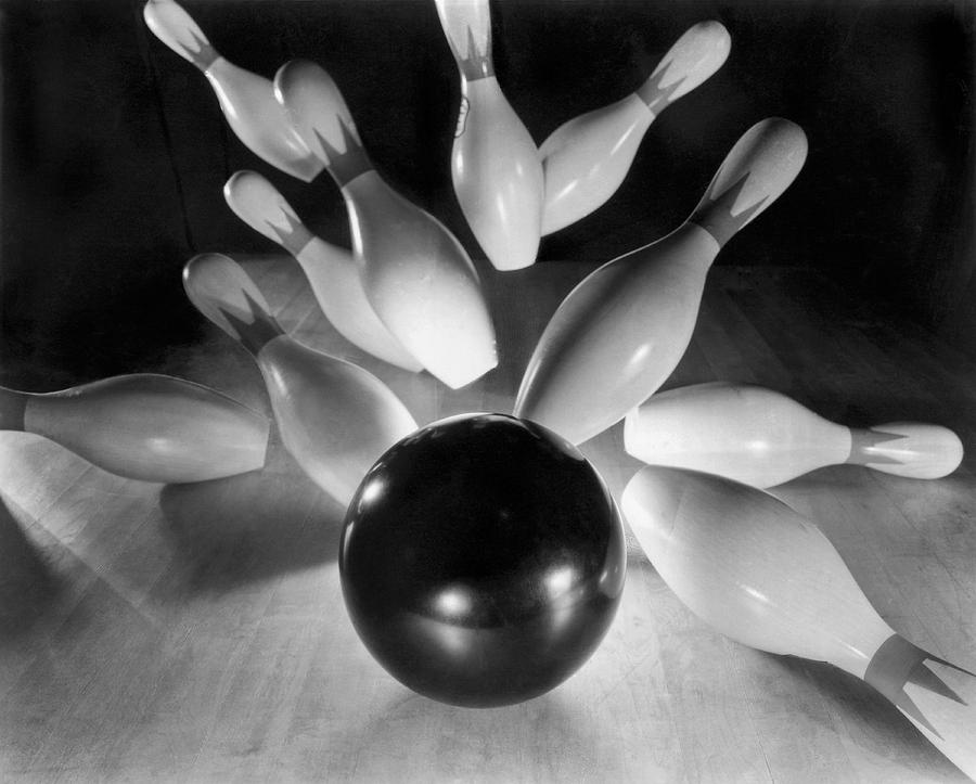 Accuracy Photograph - Bowling Ball Strikes Pins by Underwood Archives