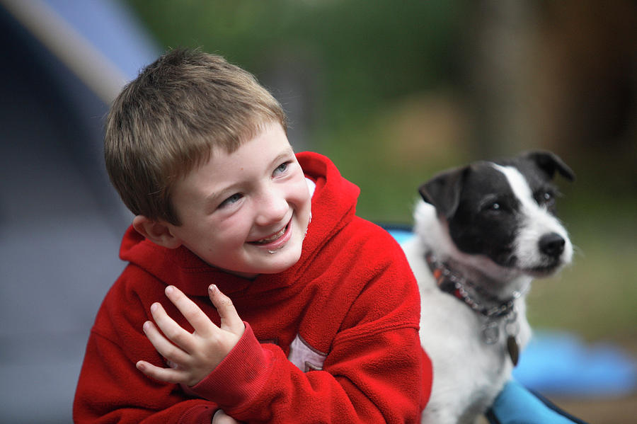 Boy Photograph - Boy, Age 6, Smiling With Jack Russell by Chris Butler