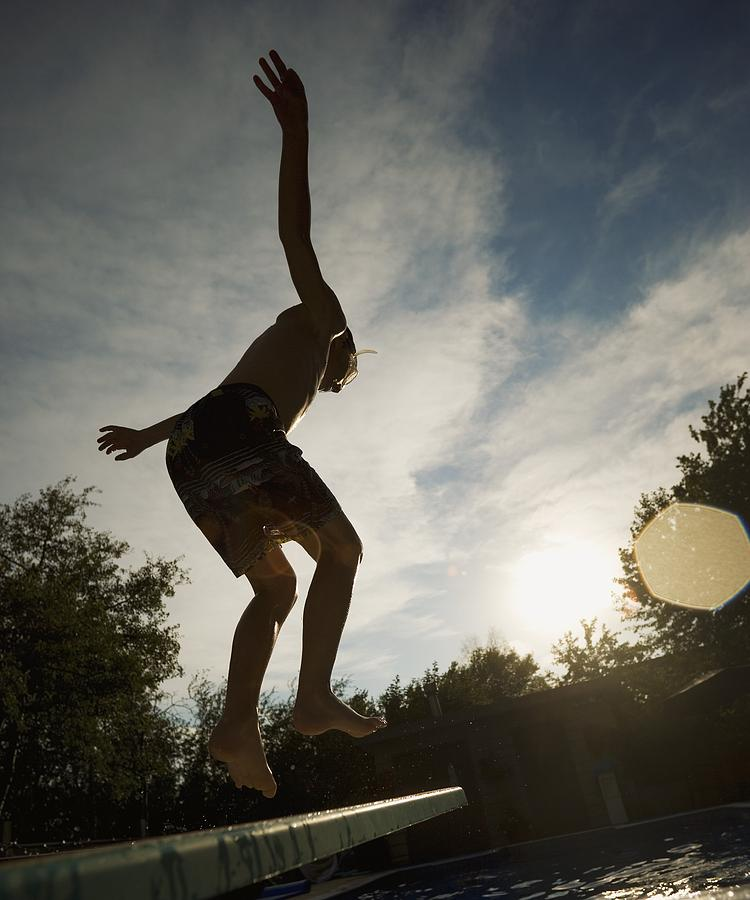 Outdoors Photograph - Boy Jumping Off Diving Board by Kelly Redinger