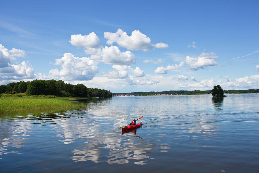 Boy Kayaking Photograph by Johner Images
