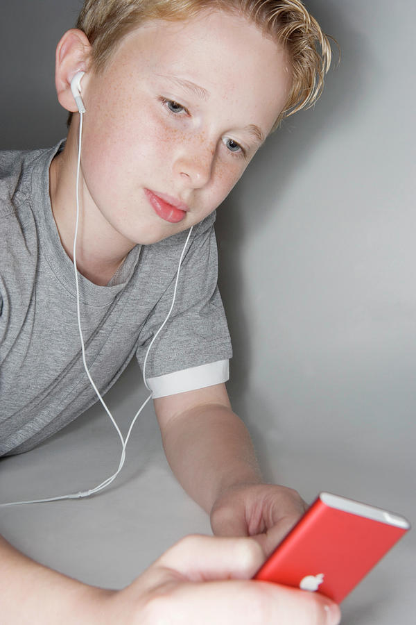 Ipod Photograph - Boy Listening To Music by Gustoimages/science Photo Library