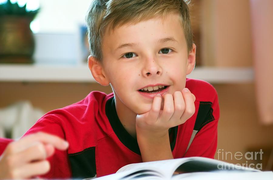 Adorable Photograph - Boy Reading Book Portrait by Michal Bednarek