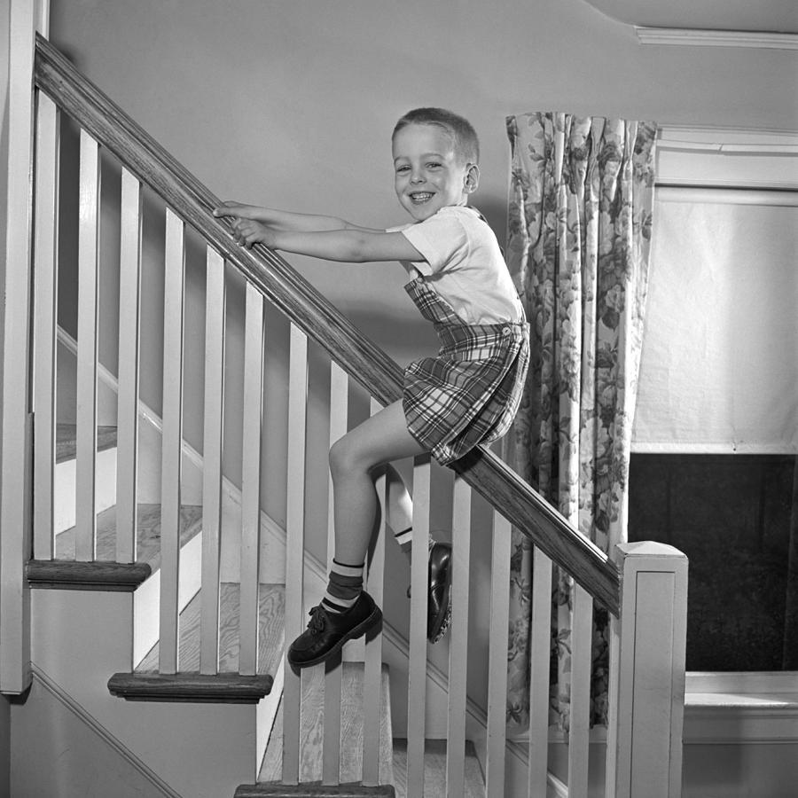 Boy Sliding Down Banister, C.1950s Photograph By E. Hibbs