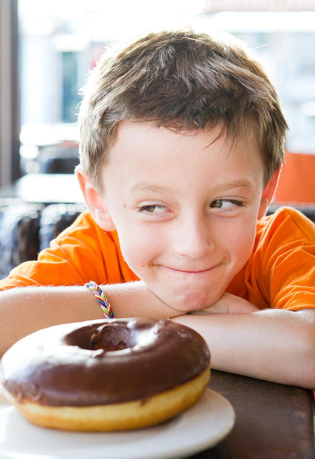Arms Photograph - Boy With Donut by Tom Gowanlock