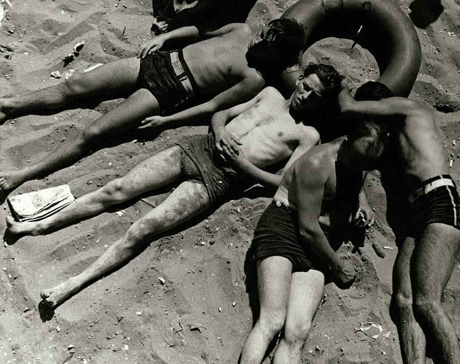 Boys Lying On The Beach At Coney Island In New Photograph by Lusha Nelson
