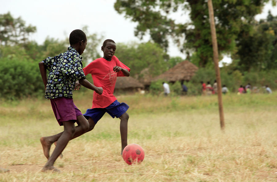Human Photograph - Boys Playing Football by Mauro Fermariello/science Photo Library