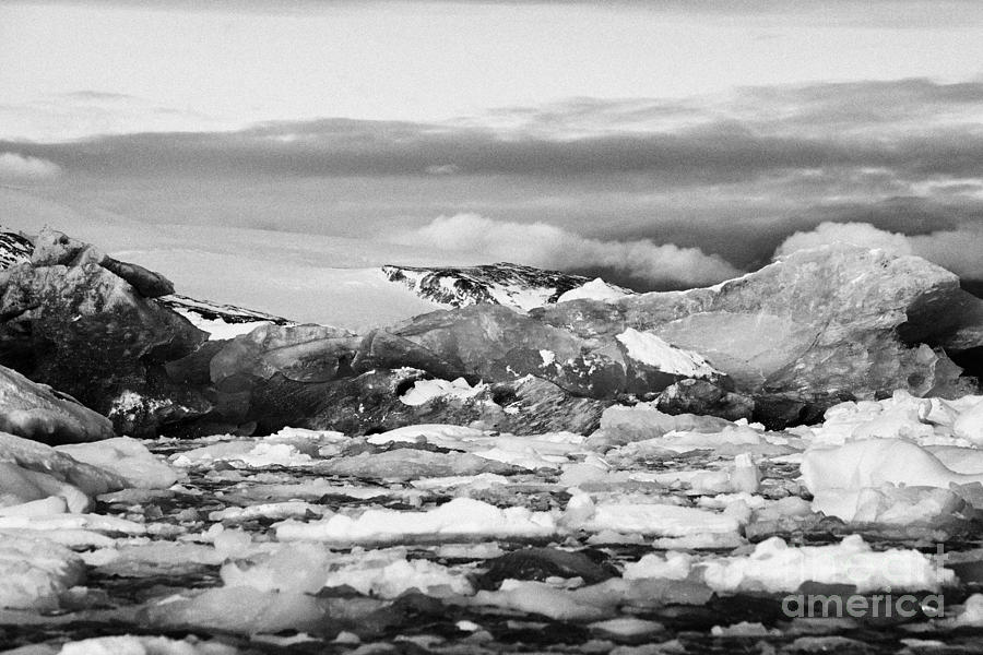 Brash Photograph - brash sea pack ice forming together with dirty blue iceberg as winter approaches cierva cove Antarct by Joe Fox
