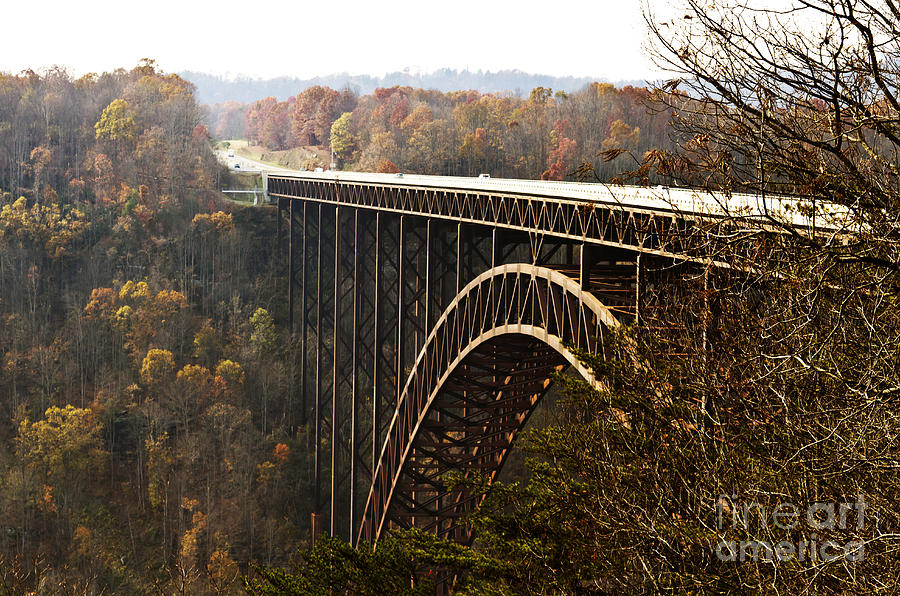 Bridge; Gorge; River; Autumn; West Virginia; Nature; Landscape; Scenic; Architecture; Arch; Suspension; Transportation; Road; Tourism; Highway; Mountains; Structure; Canyon; High; Travel; Tree; Metal; Historic; Sky; Beautiful; Landmark; Adventure; Forest; Crossing; Huge; Valley; Large; Scene; Waterway; Impressive; Industrial; Traffic; Tall; Cliff; Beauty; Colorful; Outdoor; Park; Scenery; Technology; Overpass; Transport; Freeway; Hills Photograph - Bridge by Blink Images