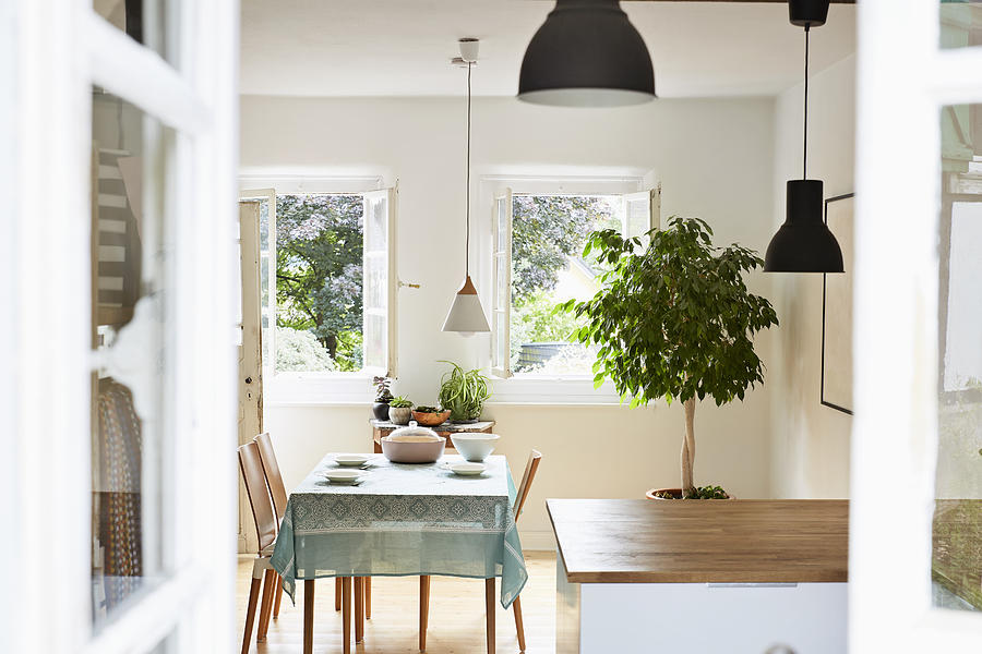 Bright Modern Kitchen And Dining Room In An Old Country House Photograph by Westend61