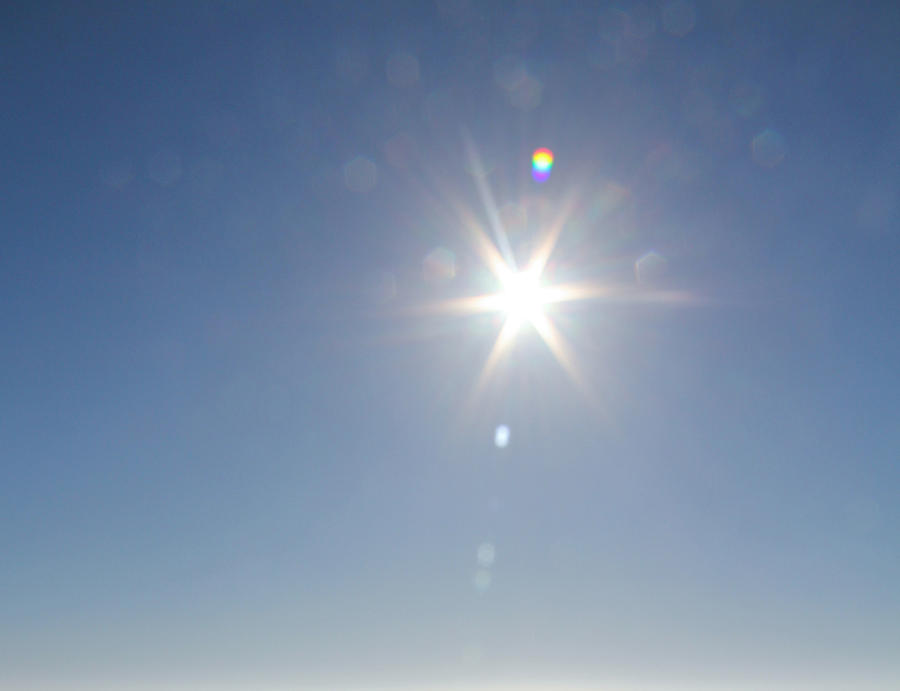 Bright Sunshine Glare Against Blue Sky Photograph by Image by Marie LaFauci