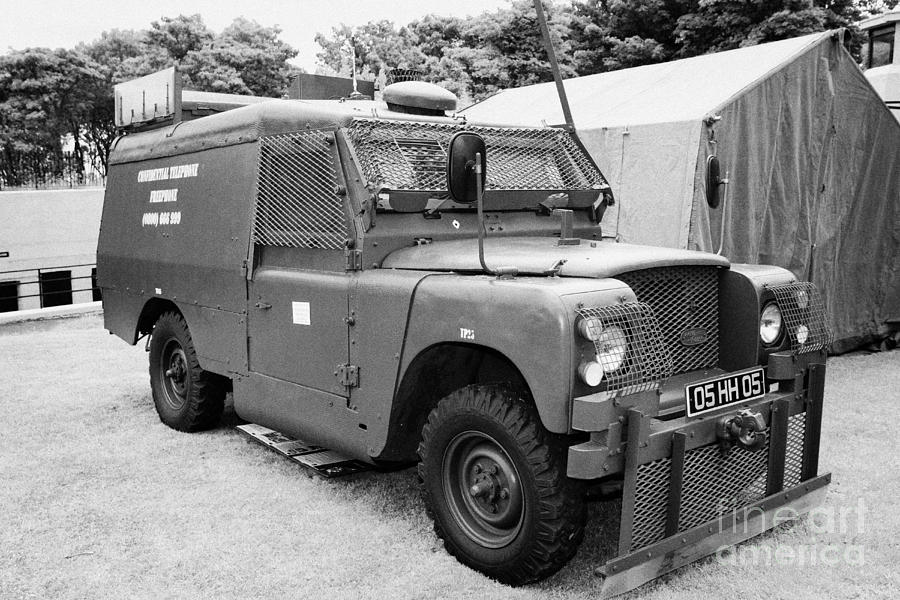 Northern Photograph - British Army Armoured Land Rover At Grey Point Fort Helens Bay County Down Northern Ireland by Joe Fox
