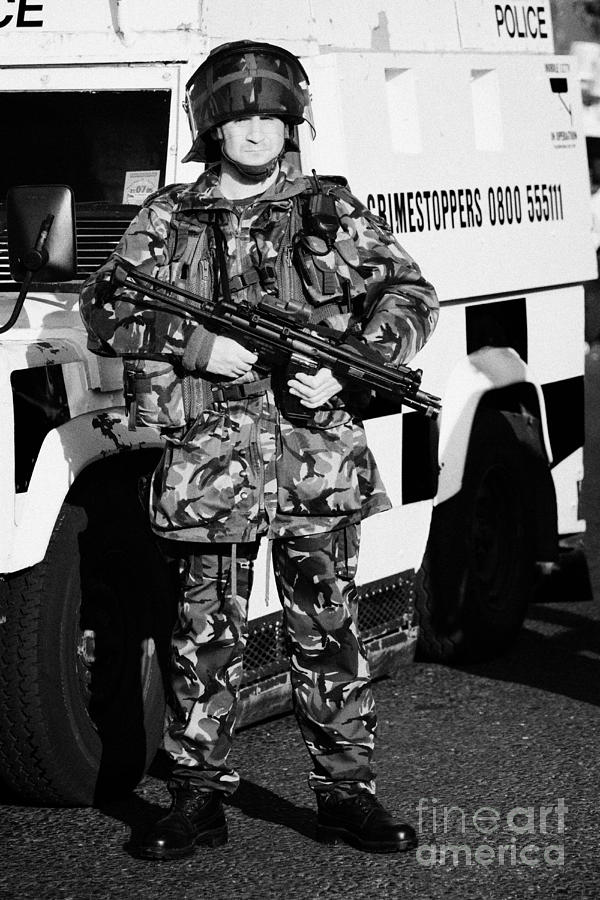 Northern Photograph - British Army Soldier With Mp5 On Crumlin Road At Ardoyne Shops Belfast 12th July by Joe Fox