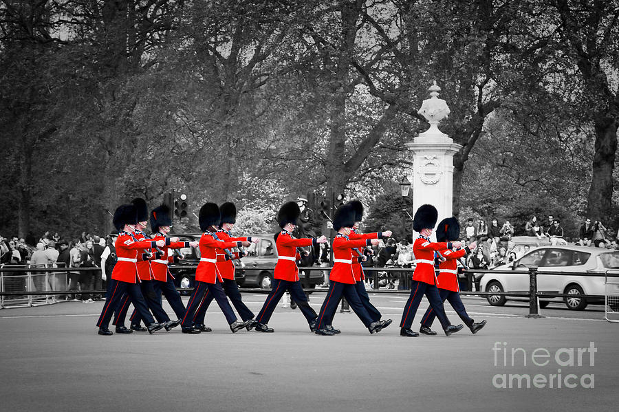 London Photograph - British Royal Guards March And Perform The Changing Of The Guard In Buckingham Palace by Michal Bednarek