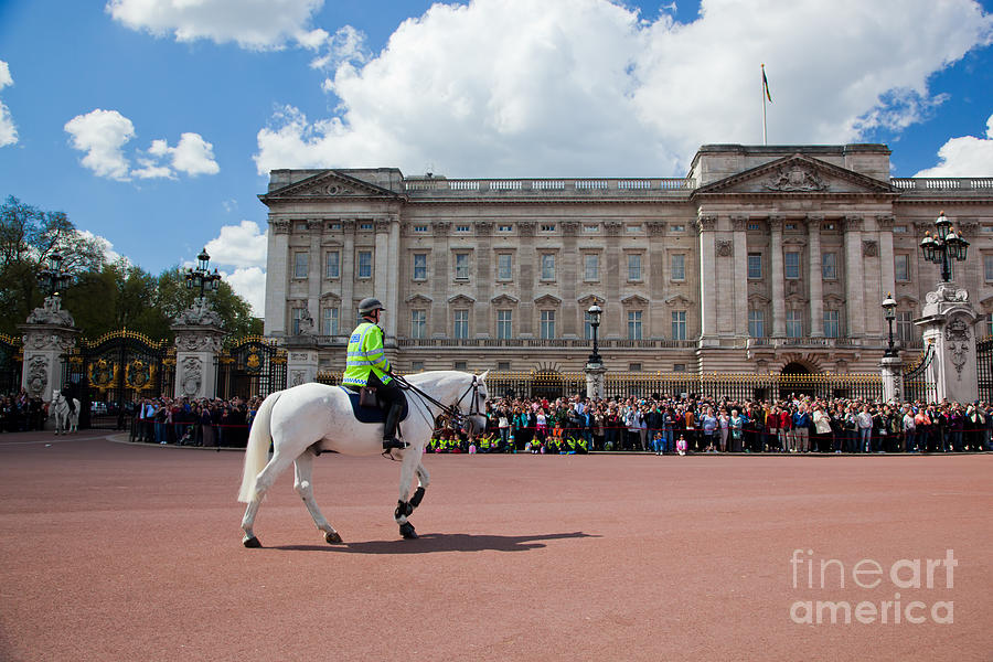 London Photograph - British Royal Guards Riding On Horse And Perform The Changing Of The Guard In Buckingham Palace by Michal Bednarek