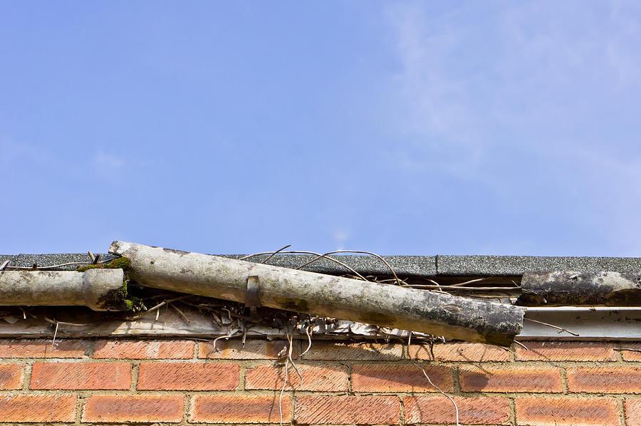 Accident Photograph - Broken Gutter by Tom Gowanlock