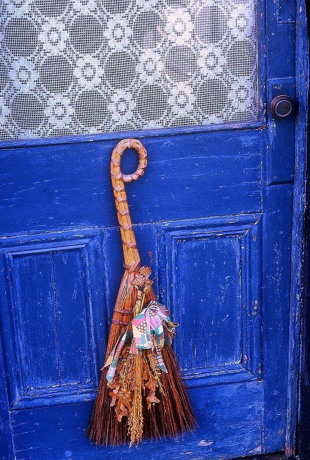 Broom On Blue Door Photograph