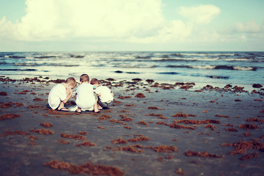 Brothers Playing In The Sand At The Photograph by Jenny Wymore - Sunkissed Photography