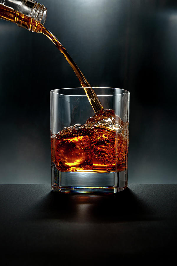 Brown Liquor Drink Pour On Black Photograph by Chris Stein