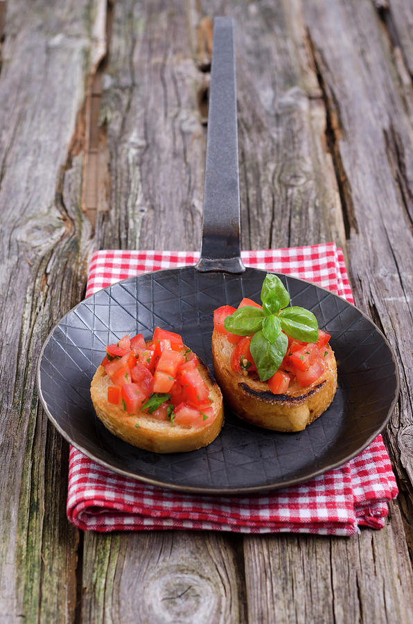 Bruschetta In Frying Pan On Napkin Photograph by Westend61