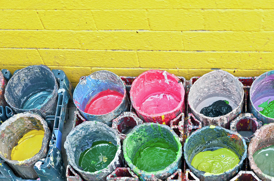 Buckets Of Colored Paints And A Yellow Photograph by Travelif