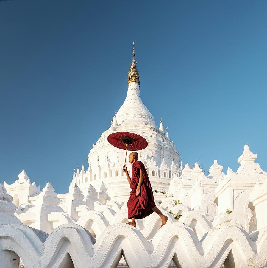 Buddhist Monk Walking Across Arches Of Photograph by Martin Puddy