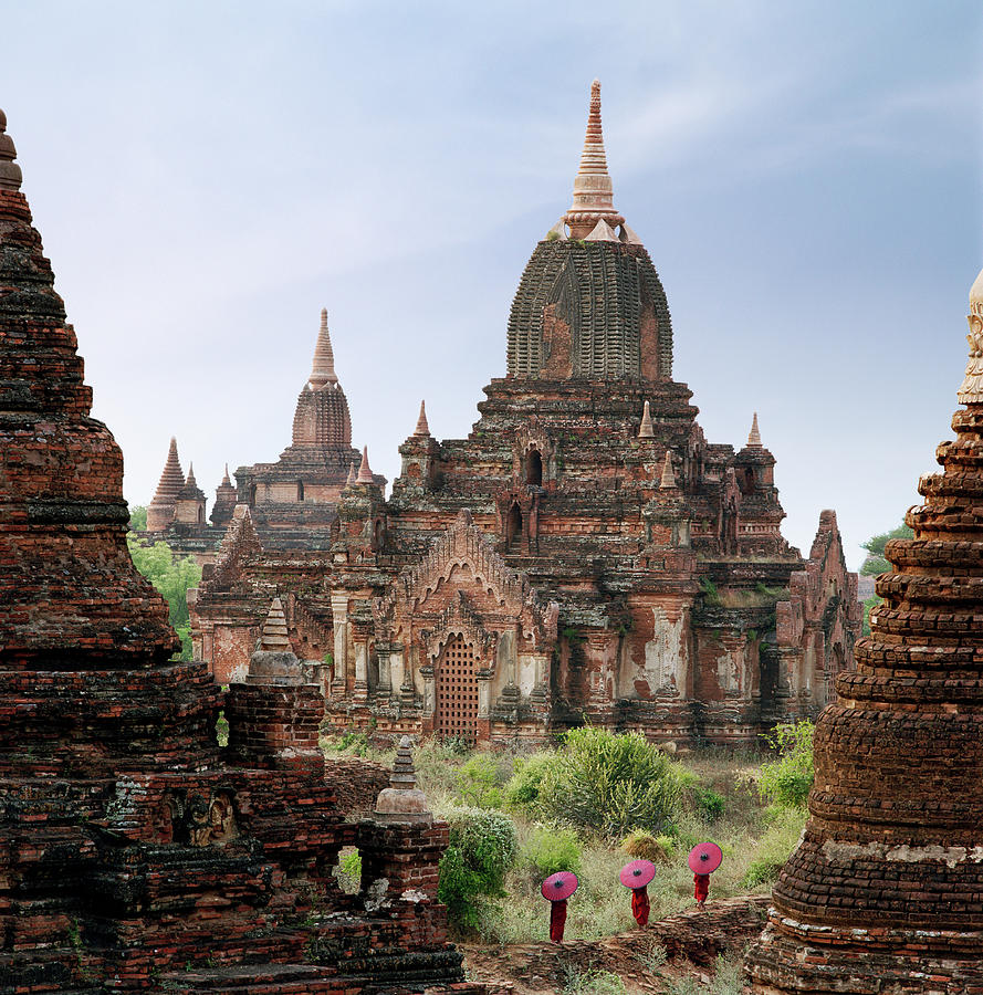 Buddhist Monks Walking Past Temple Photograph by Martin Puddy