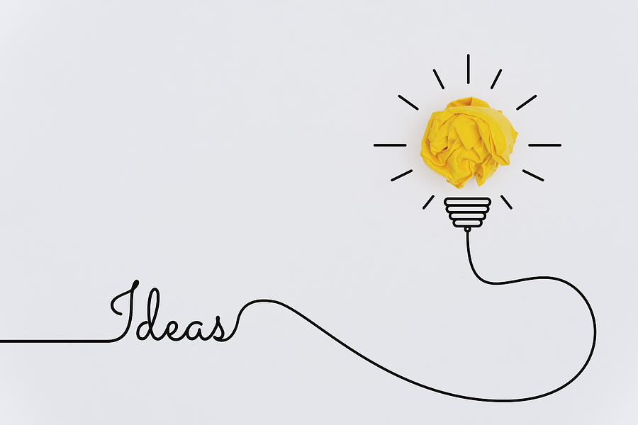 Bulb Idea Concepts with Yellow Crumpled Paper Ball Photograph by Constantine Johnny