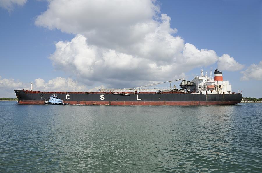 Cargo Ship Photograph - Bulk Cargo Ship With Tug Escort by Bradford Martin